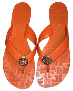 Tory Burch orange and gold Sandals