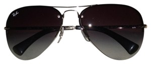 Ray-Ban Ray-Ban 3449 rimless aviators in dark grey. Never worn. No scratches. comes with case