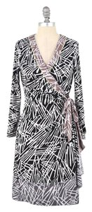 BCBGMAXAZRIA short dress Black/White Mixed Print Longsleeve Wrap on Tradesy