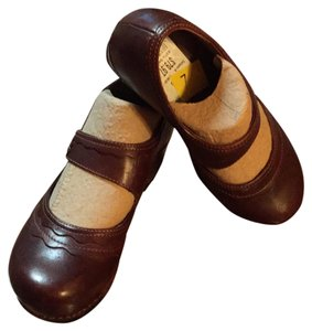 Dansko brown. Mules