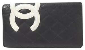 Chanel Black while Clutch