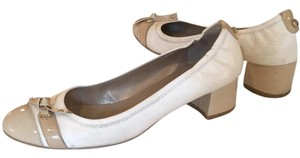 Stuart Weitzman cream and camel Flats