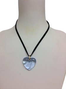 Baccarat Blue Baccarat heart pendant on black cord
