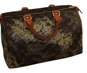 Louis Vuitton Satchel in brown with gold lace