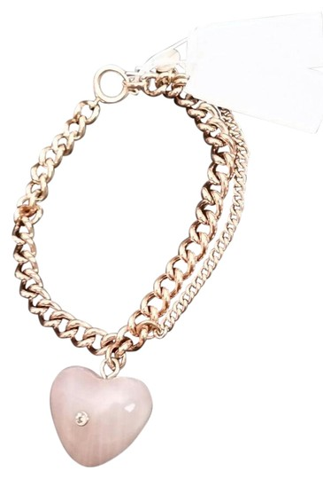 Preload https://img-static.tradesy.com/item/21294239/michael-kors-rose-gold-tone-carved-heart-pink-quartz-charm-bracelet-0-1-540-540.jpg