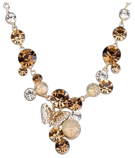 Preload https://item1.tradesy.com/images/gold-brown-swarovski-crystal-the-luna-butterfly-necklace-21295450-0-1.jpg?width=440&height=440