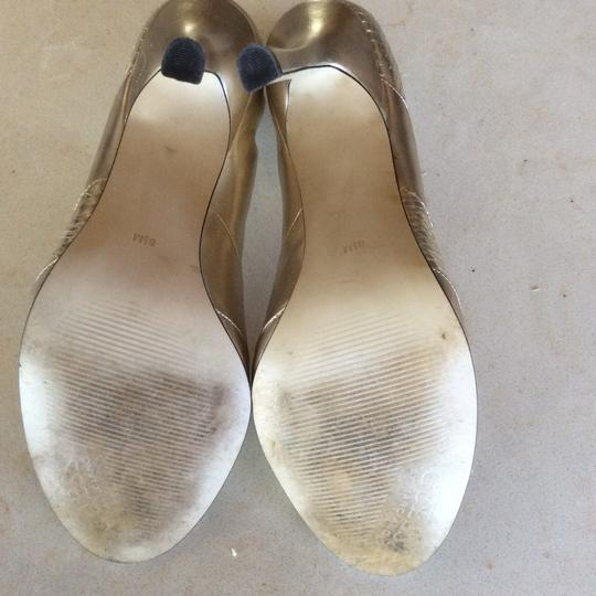 Guess Gold Pumps