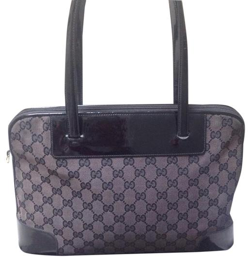 Preload https://item5.tradesy.com/images/gucci-monogram-blackbrown-signature-canvaspatent-leather-trim-satchel-21296659-0-1.jpg?width=440&height=440