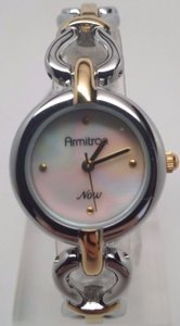 Armitron Ladies Gold and Silver MOP Dial Watch NEEDS NEW BATTERY!!!
