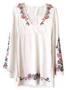 Free People short dress White, Red, Gold, and Black on Tradesy
