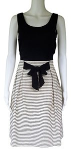 The Limited short dress Black, Ivory Bow Pleated on Tradesy