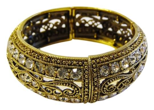 Preload https://item2.tradesy.com/images/real-collectibles-by-adrienne-goldtone-stretch-crystal-bangle-size-75-bracelet-2130176-0-0.jpg?width=440&height=440