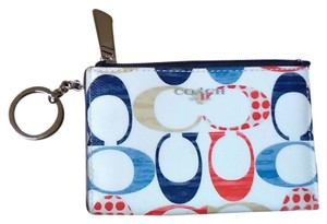 Coach Wristlet in White with blue, red and tan details.