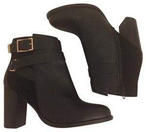 Topshop Black leather with black suede accents & gold hardware. Inside zipper closure. Boots