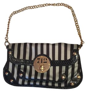 Henri Bendel Wristlet in black, white, gold