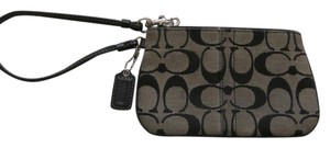 Coach Wristlet in Black/Tan