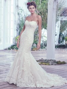 Maggie Sottero Lace Artfully Placed Atop Tulle Adds Sophistication To This Feminine F Wedding Dress