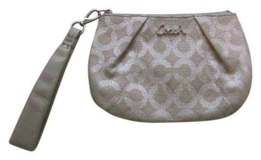 Preload https://item2.tradesy.com/images/coach-tansilver-canvas-wristlet-2131406-0-0.jpg?width=440&height=440
