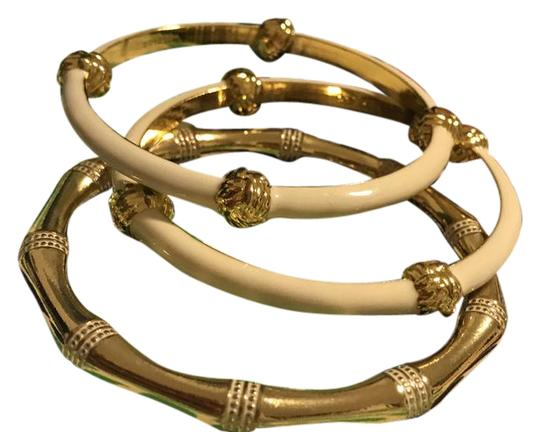 Preload https://img-static.tradesy.com/item/21315507/lilly-pulitzer-gold-and-white-bamboo-bangle-set-bracelet-0-1-540-540.jpg