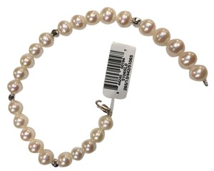 Fine Pearl/Opaque cultured pearl bracelet Pearl bracelet with silver bead and lobster claw silver clasp