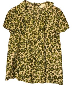 Kate Spade Top Green leopard on white background.