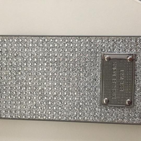 Michael Kors iPhone 5 case, iPhone 6 case $20. each, total $40 Image 1