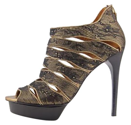 Preload https://img-static.tradesy.com/item/21324991/elie-tahari-black-gold-tonie-sandal-platforms-size-us-8-regular-m-b-0-2-540-540.jpg