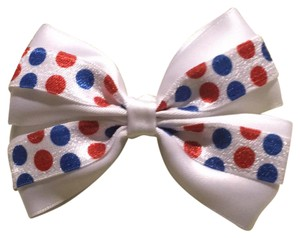 Other Handmade white satin bow decorated with blue and red polka dots elastic.