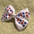 Other Handmade white satin bow decorated with blue and red polka dots elastic. Image 1