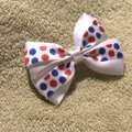 Other Handmade white satin bow decorated with blue and red polka dots elastic. Image 2