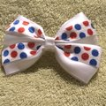 Other Handmade white satin bow decorated with blue and red polka dots elastic. Image 3