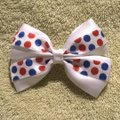 Other Handmade white satin bow decorated with blue and red polka dots elastic. Image 4