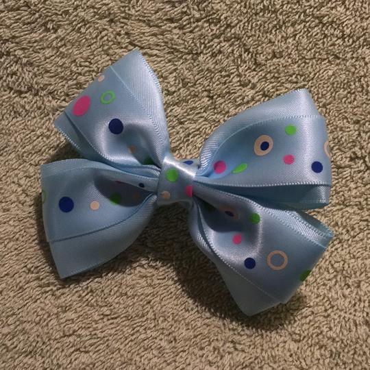 Other Handmade light blue decorated with a polka dots satin bow on aligator clip. Image 1
