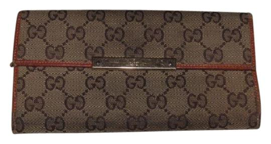 Preload https://img-static.tradesy.com/item/21326280/gucci-brown-large-g-logo-print-canvas-and-orangebrown-leather-vintage-walletdesigner-wallet-0-1-540-540.jpg