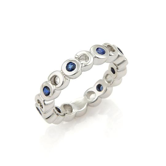Preload https://img-static.tradesy.com/item/21329469/chanel-white-and-blue-20639-sapphire-coco-eternity-18k-band-ring-0-0-540-540.jpg