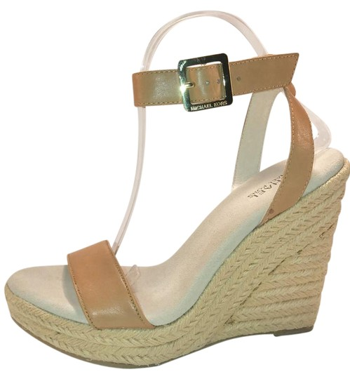 Preload https://img-static.tradesy.com/item/21330467/michael-kors-brown-leather-wedge-with-ankle-strap-sandals-size-us-95-regular-m-b-0-1-540-540.jpg