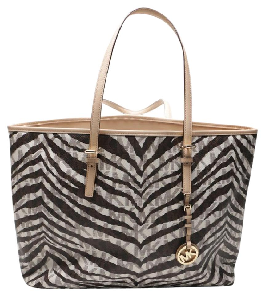 9b41f59c2a0a Michael Kors Jet Set Multifunction Travel Tiger Leather and Pvc Tote ...