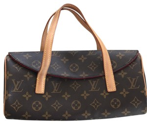 Louis Vuitton brown and tan Clutch