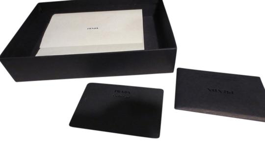 Preload https://item1.tradesy.com/images/prada-black-saffiano-leather-trifold-wallet-2133355-0-0.jpg?width=440&height=440