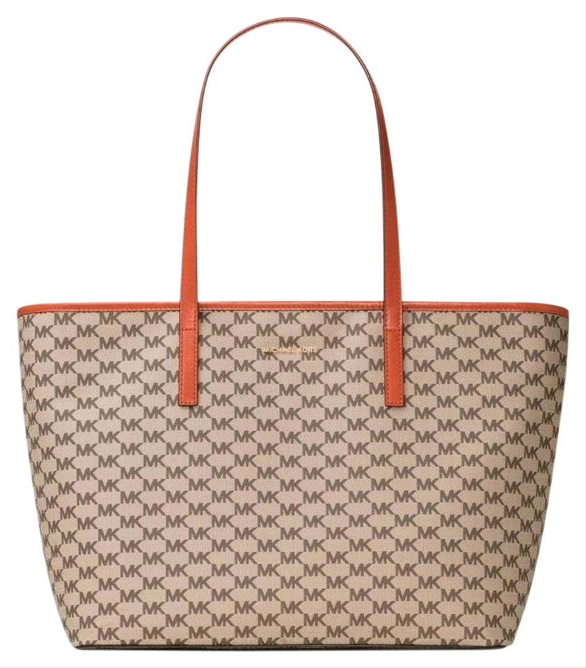 2551a7c1bff7 ... Michael Kors Signature Coated Canvas Emry Tote in NATURAL ORANGE .