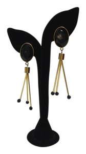 Marni Gold dangling clip on earrings with black stones