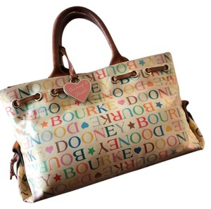 Dooney & Bourke Satchel in off white and multi color lettering.