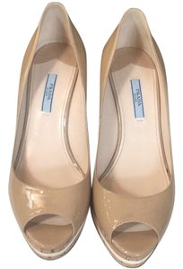 Prada nude patent leather Wedges