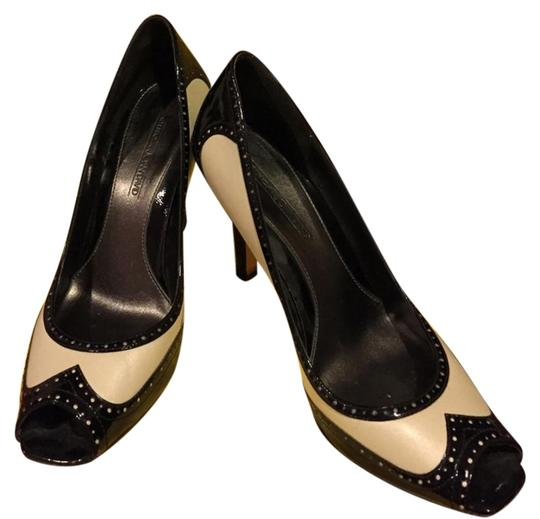 Preload https://item4.tradesy.com/images/circa-joan-and-david-ivory-and-black-pumps-2134543-0-1.jpg?width=440&height=440