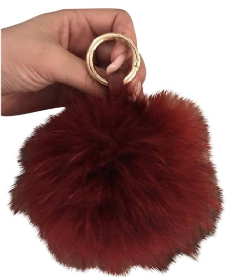 Preload https://img-static.tradesy.com/item/21346011/oxblood-fur-bag-charm-poof-key-chain-in-red-0-1-540-540.jpg
