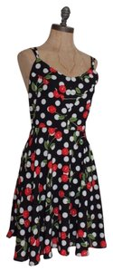Everly short dress MULTI Cherry Crisscross Strap Fit And Flare on Tradesy
