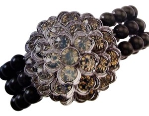 Lia Sophia Beautiful multi strand stretch bracelet with medallion focal.