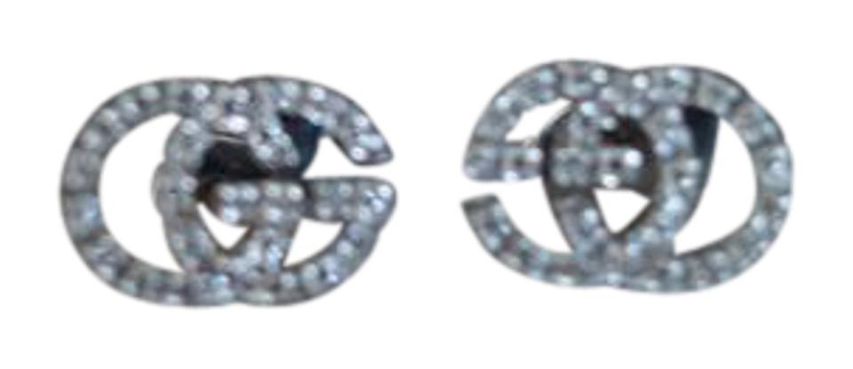 396205bbf0f Gucci Gucci 18K White Gold with Diamonds Running GG Stud Earrings Image 0  ...