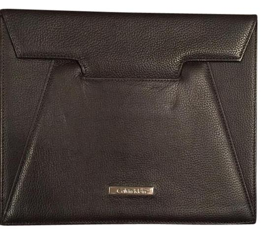 Preload https://item1.tradesy.com/images/calvin-klein-brown-leather-clutch-21369205-0-1.jpg?width=440&height=440