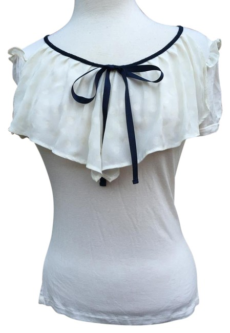 Preload https://img-static.tradesy.com/item/21370350/creme-cap-sleeve-lace-overlay-ribbon-tie-ruffle-shoulder-blouse-size-6-s-0-1-650-650.jpg